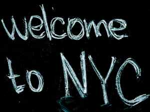 black background with welcome to nyc text overlay