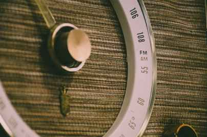 round white and gray lens on brown textile